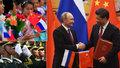 Putin si plácl s Čínou na rychlovlak i nové letadlo. Vítali ho děti s vlaječkami