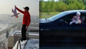 Šílený otec hazarduje s životem dítěte! Za nohu visí z okraje střechy nebo z okýnka BMW