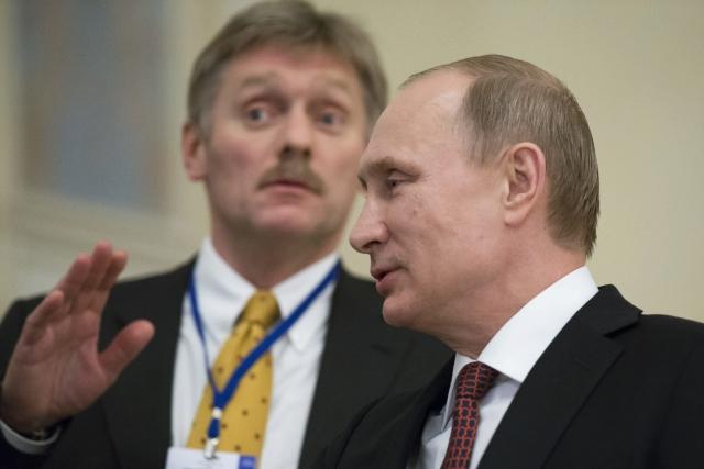 Dmitrij Peskov a Vladimir Putin