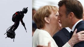 Na Macrona pískali, Merkelová se k němu tulila. A létající voják zaujal davy