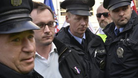 Předseda Národní demokracie Adam B. Bartoš byl zatčen a obviněn ze tří činů proti lidskosti.