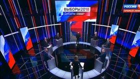 Vzrušené debaty kandidátů na ruského prezidenta se účastnilo sedm mužů a jediná žena. Hlavní favorit voleb - Vladimir Putin - do televizního studia nedorazil