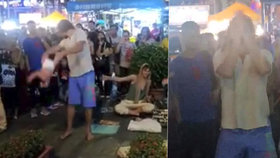 Ruský pár je v malajsijské vazbě za nehorázné pouliční představení.