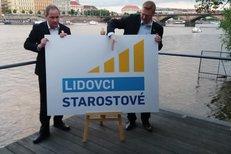 Pavel Bělobrádek (KDU-ČSL) a Petr Gazdík (Starostové) představují logo nové koalice.