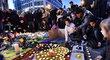 Po setmění v Bruselu začali lidé chodit ven a dávat svíčky na náměstí